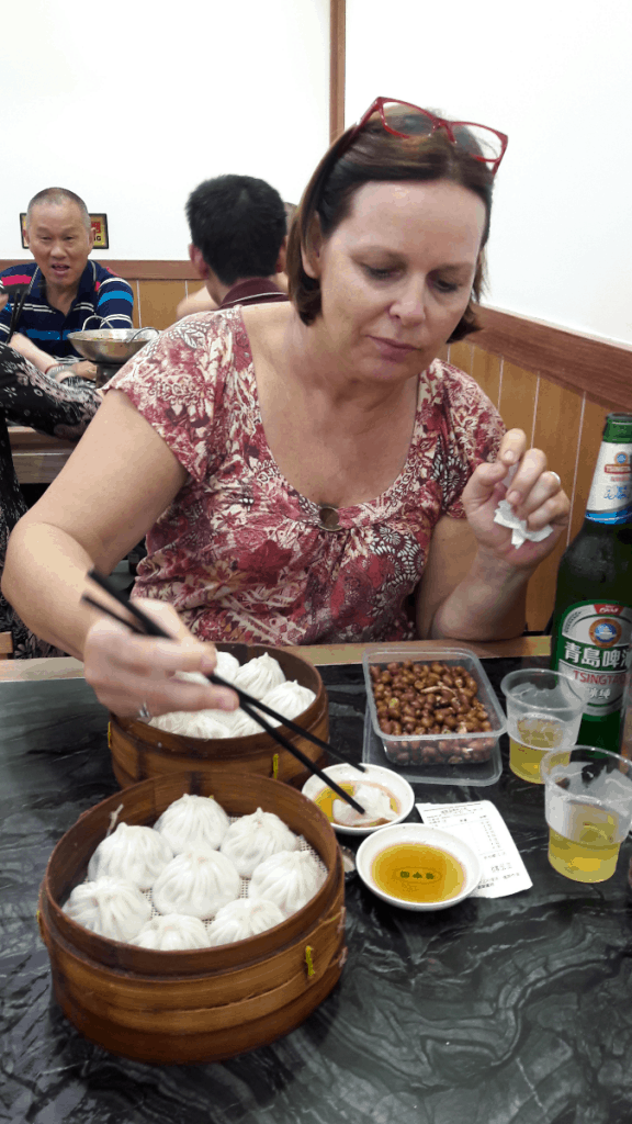 girl eating Chinese dumplings