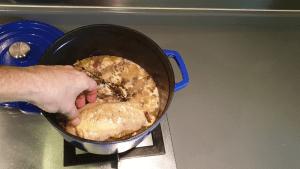 adding chicken in pot