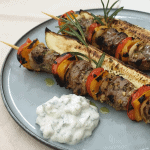 Lamb skewers with rosemary-garlic and grilled marrow