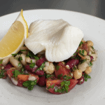 Poached snow fish with mixed bean salad and bacon dressing
