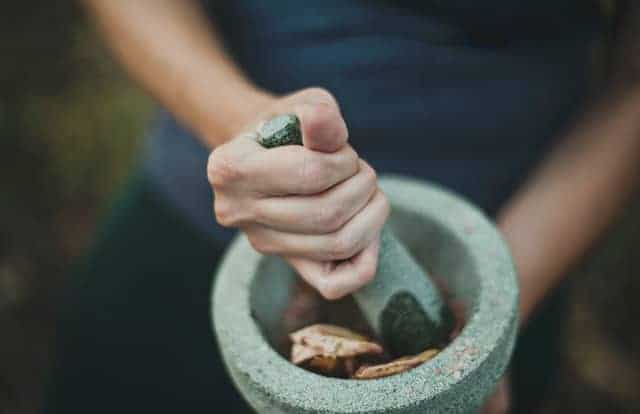 grinding dried herb